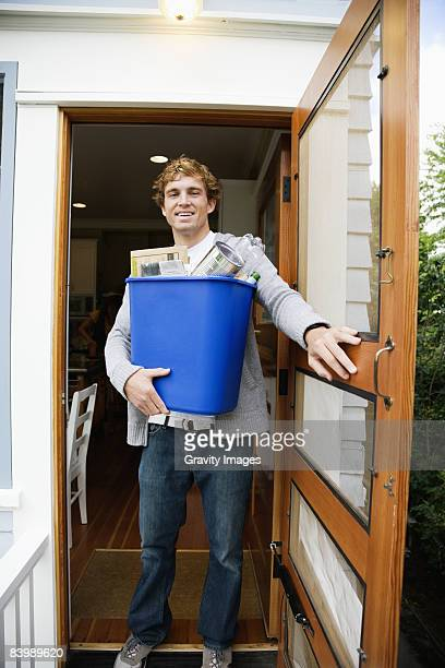 Man Taking Out the Recycling