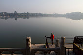 A man taking part in morning exercises in Beihai Park an imperial garden to the northwest of the Forbidden City in Beijing China First built in the...