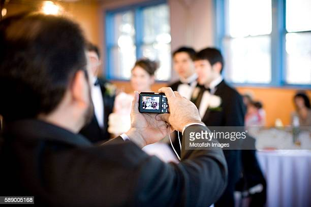 Man Taking Photo at Quinceanera Party