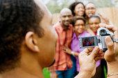 Man taking photo of friends