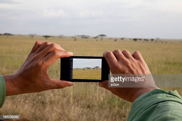 Man taking photo with moble phone