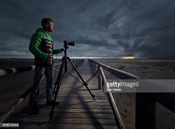 Man taking photos at sunset.
