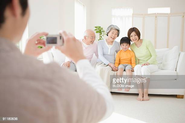 Man taking picture of family