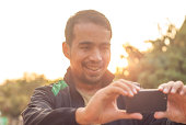 A Man Taking Picture With Digital Camera