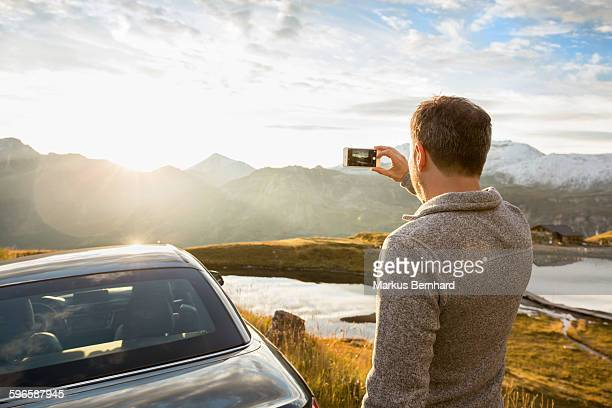 Man taking picture with his cell phone