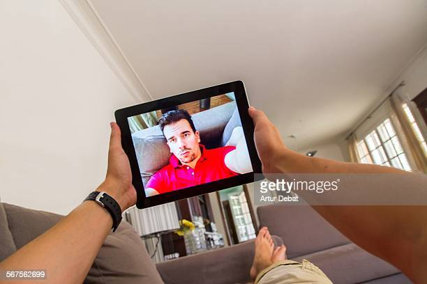 Man taking selfie at home from POV with duck face.