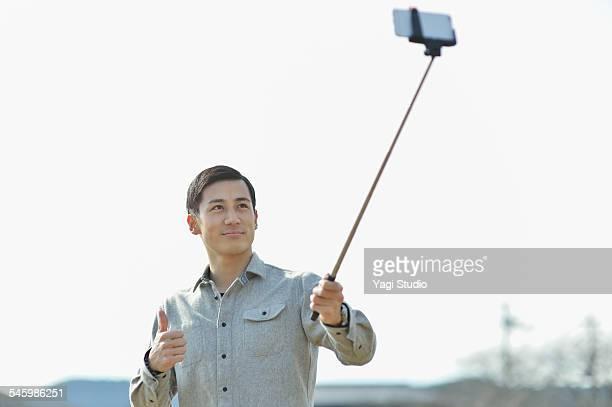 Man taking selfie using smartphone