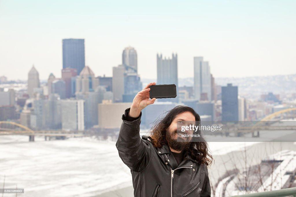 Man Taking Selfie With Gloomy Winter Pittsburgh Skyline