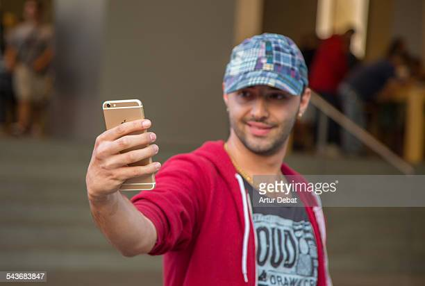 Man taking selfie with his new and first iPhone 6 sold on Barcelona city in front the Apple Store Catalonia Europe
