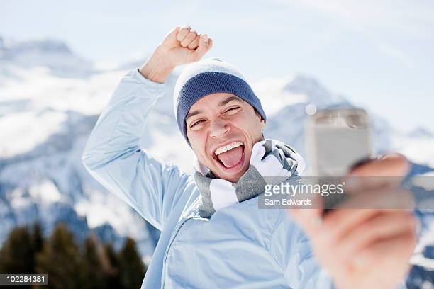 Man taking self-portrait with cell phone