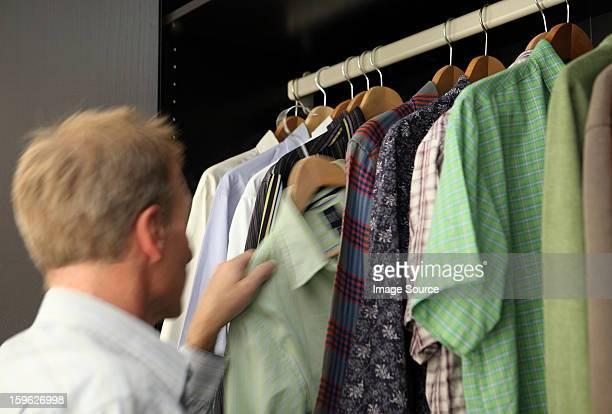 Man taking shirt from wardrobe