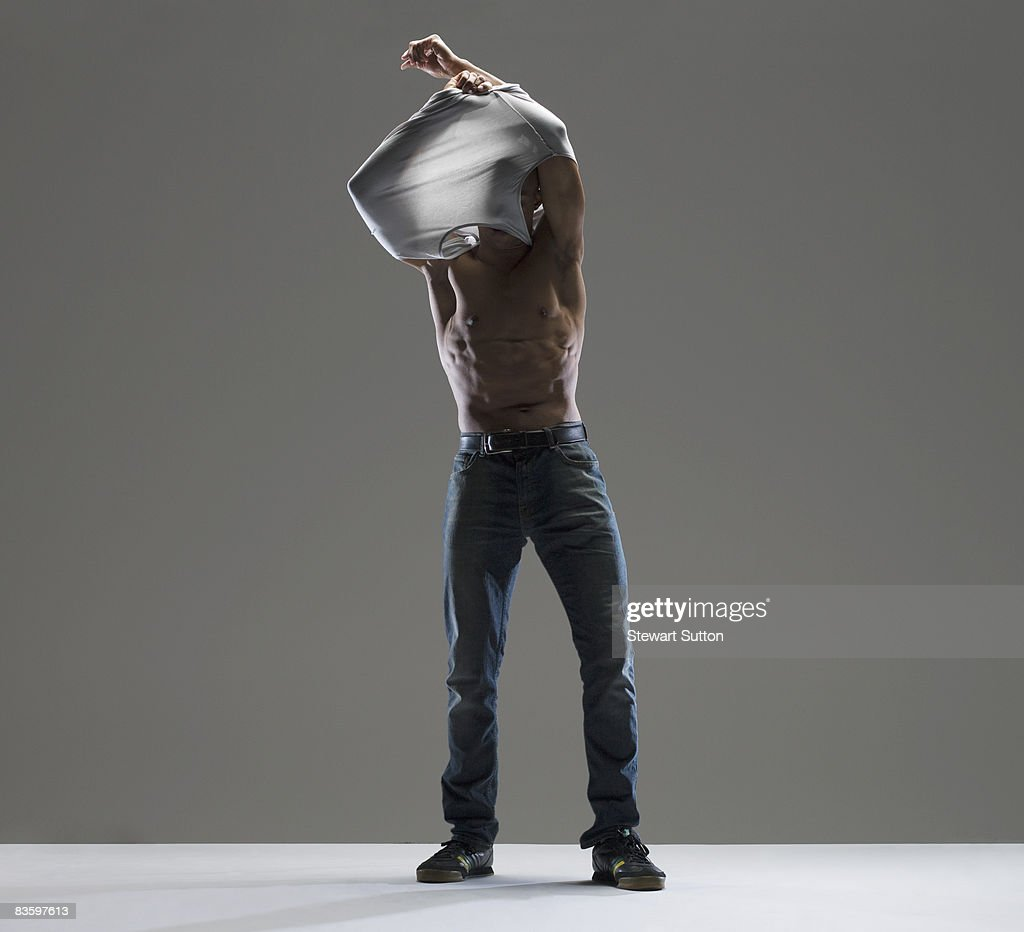 man taking shirt off : Stock Photo