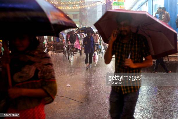 OLD DHAKA DHAKA BANGLADESH A man talk mobile phone when heavy rainfall made in Dhaka city The death toll rises to 150 in several hill districts...