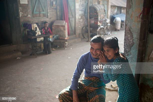 A man talk on mobile phone with dear one while her daughter also trying to hear the converrsation at Debar Par Dighi on January 14 2015 in Agrabad...