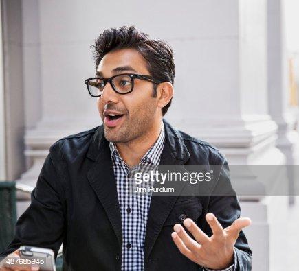 Man talking at sidewalk cafe