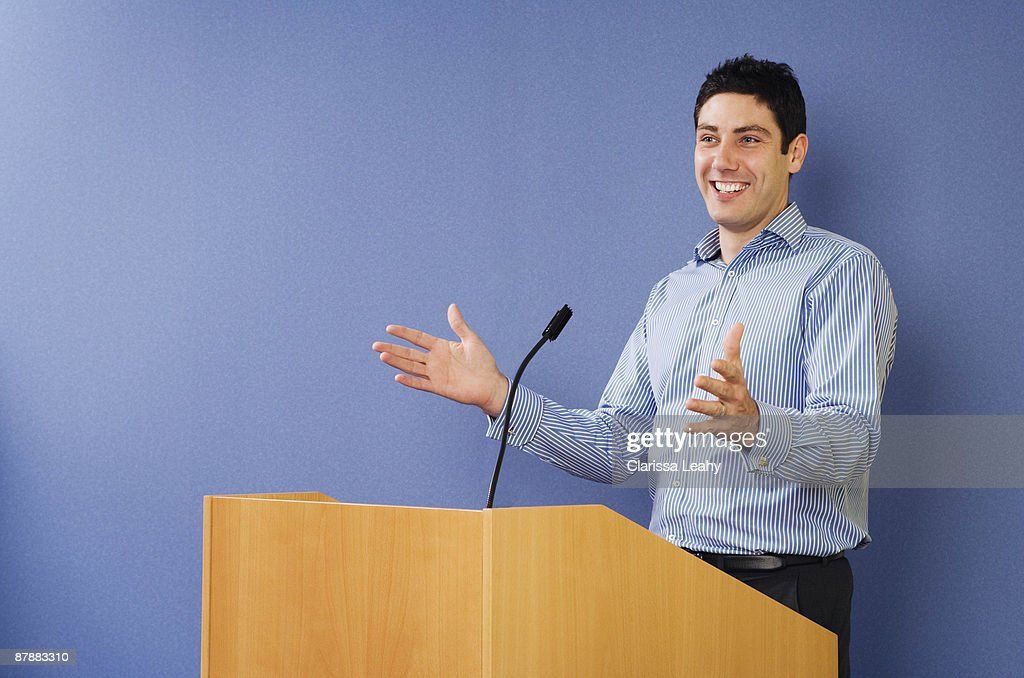 Man talking from lectern : Stock Photo