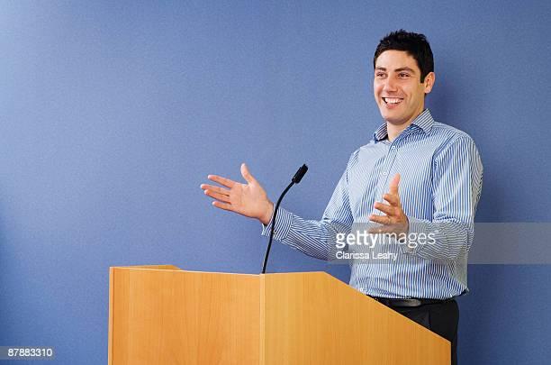 Man talking from lectern