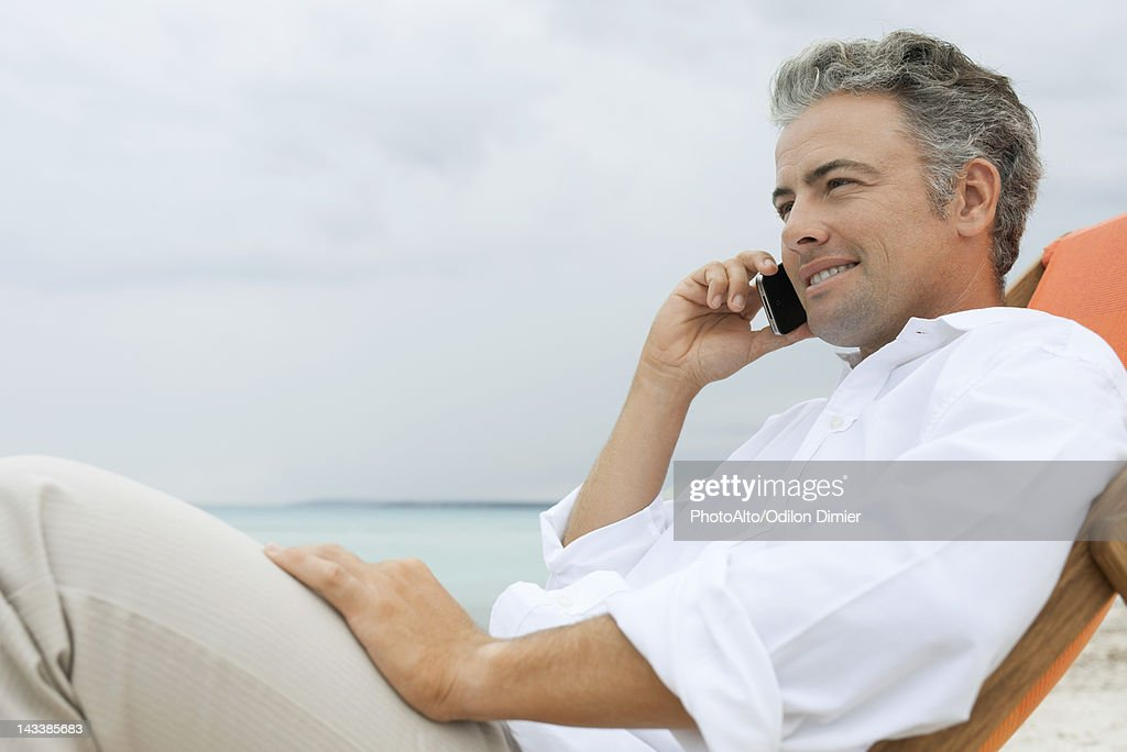 Man Talking On Cell Phone At The Beach Stock Photo | Getty ...