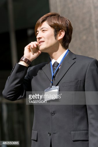 Man talking on mobile phone : Stock Photo