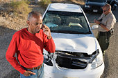 Man talking on phone after car accident