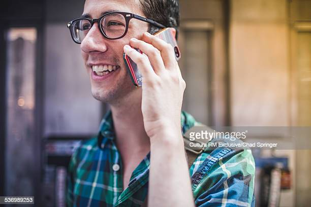 Man talking on phone in street