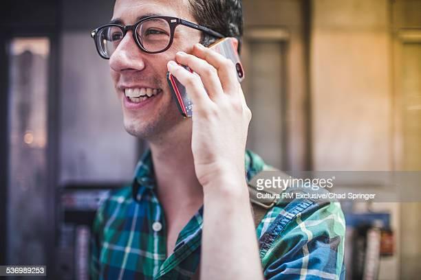 Man talking on phone in street