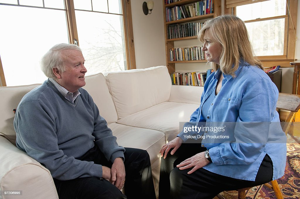 Man talking to female therapist