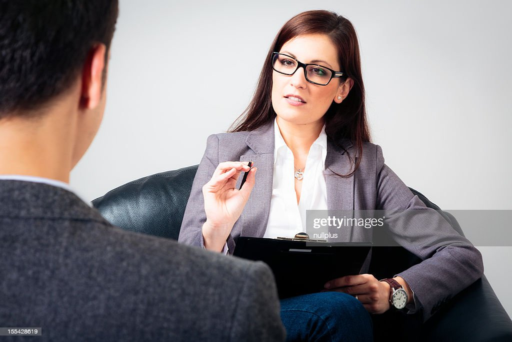 man talking to his psychologist : Stock Photo