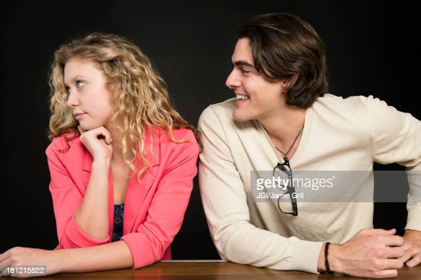 Man talking to uninterested woman
