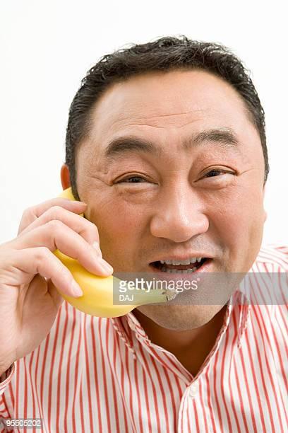 Man talking with a banana
