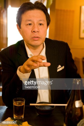 Man talking with calm expression : Stock Photo