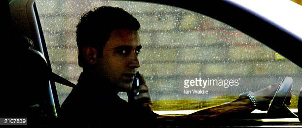 A man talks a mobile phone while driving in traffic June 24 2003 in London England The government has announced plans for a ban on talking on...