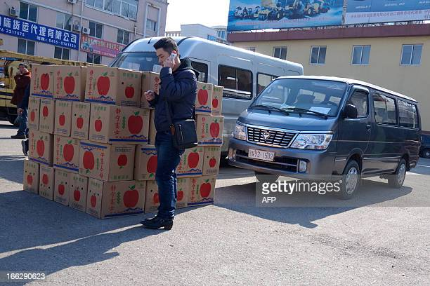 A man talks on a cellphone as he waits for dispatch at a customs port in the Chinese border city of Dandong in China's northeastern Liaoning province...