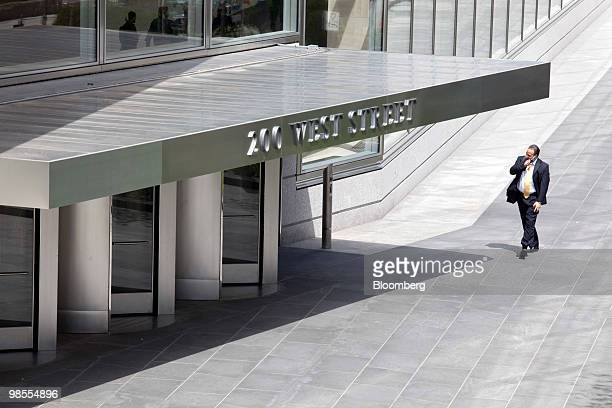 A man talks on a mobile phone outside Goldman Sachs Group Inc's new headquarters building at 200 West Street in New York US on Monday April 19 2010...
