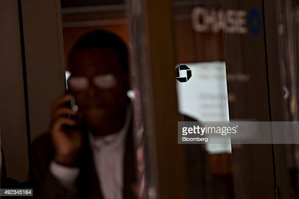 A man talks on a mobile phone while exiting a JPMorgan Chase Co bank branch in Chicago Illinois US on Monday Oct 5 2015 JPMorgan Chase Co is...