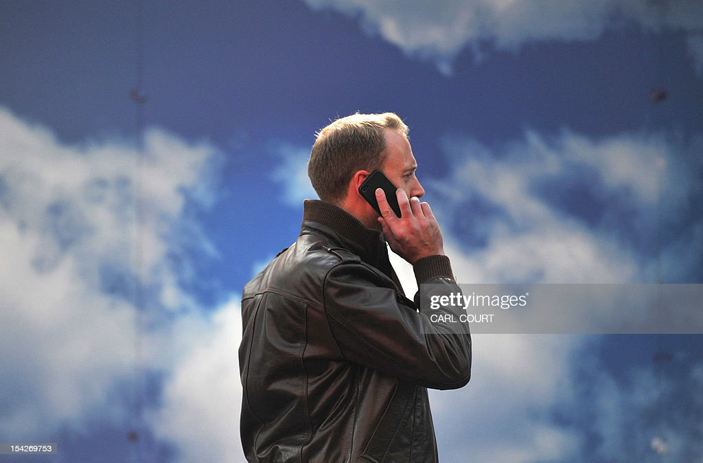 A man talks on his mobile phone in central London on October 17, 2012. The number of unemployed people in recession-hit Britain fell by 50,000 to 2.53 million in the quarter to August from the total in the previous quarter, official data showed.