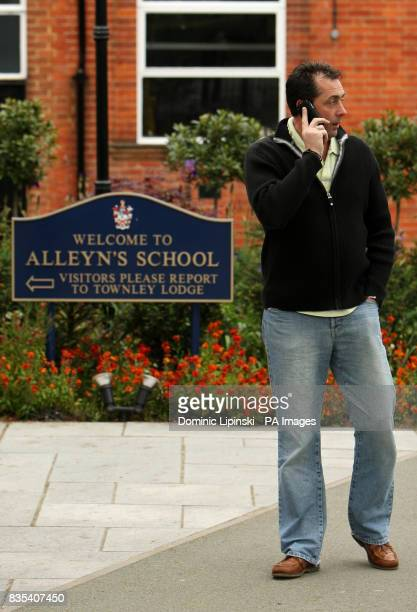 A man talks on his mobile phone outside Alleyn's School in Dulwich south east London which is distributing Tamiflu to parents following confirmed...