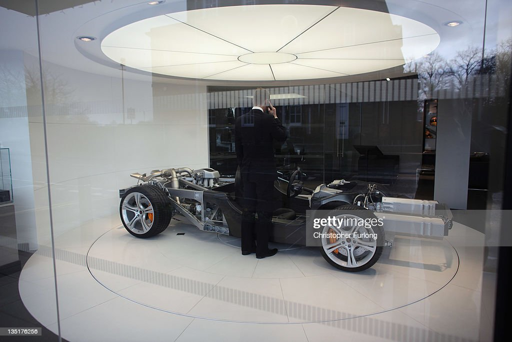 A man talks on the telephone inside the McLaren super car showroom on December 7, 2011 Knutsford, England. With a weak outlook at the start of the Christmas shopping boom, many retailers are slashing prices with the hopes of combating weak sales.