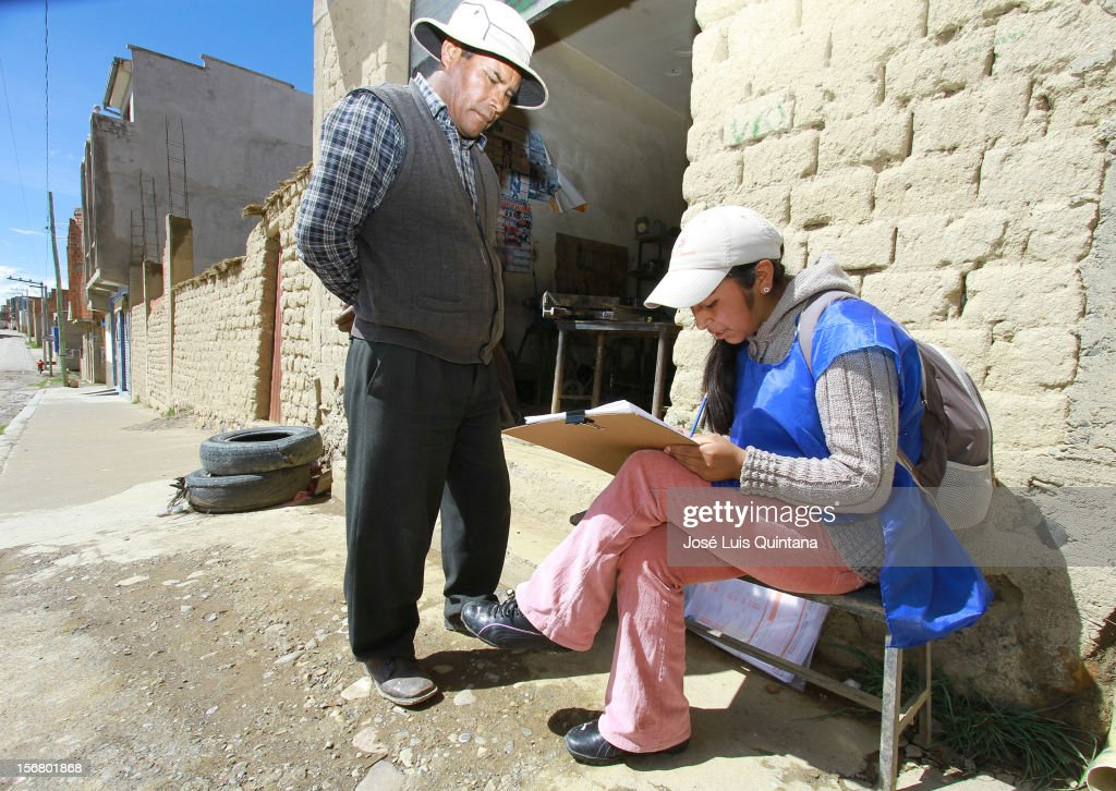 Man talks to the enumerator during the bolivian national census on November 21, 2012 in La Paz, Bolivia.
