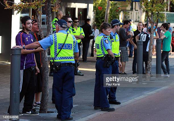 A man talks with police officers after trouble broke out between fans at the Elephant and Wheelbarrow pub after the ALeague Grand Final between the...