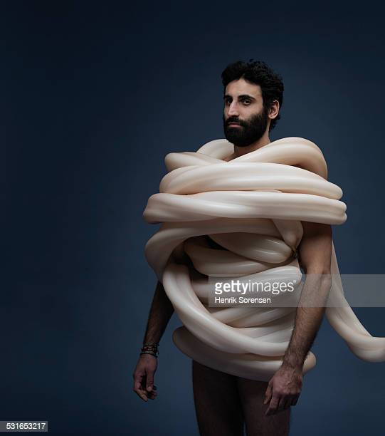 man tangled in by large balloon