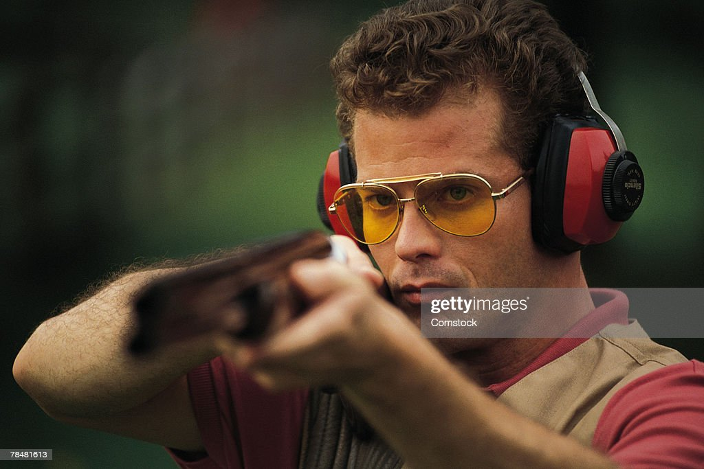 Man target-shooting with rifle
