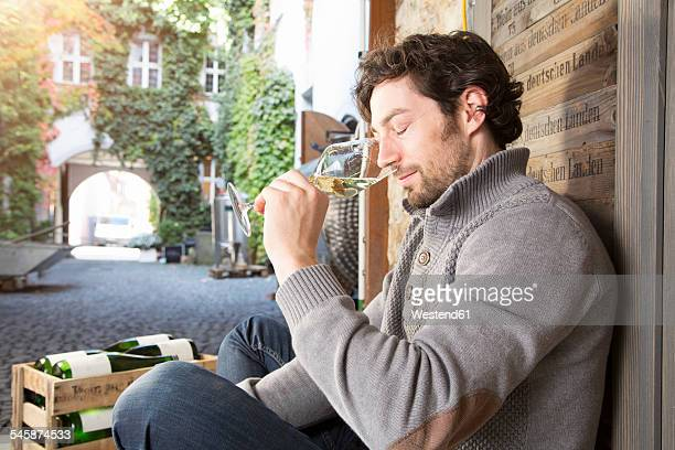 Man tasting wine at wine estate