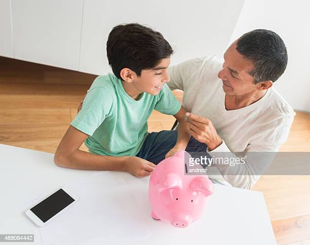 Man teaching his boy to save money