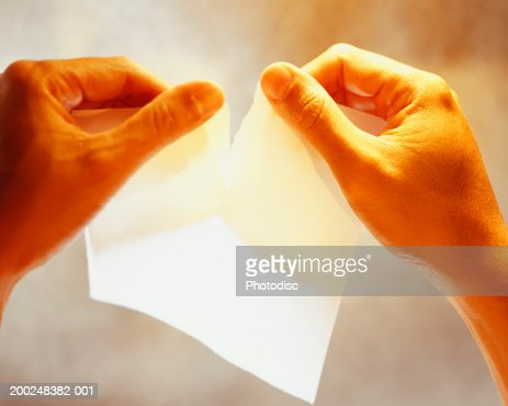 Man tearing paper, Close-up of hands