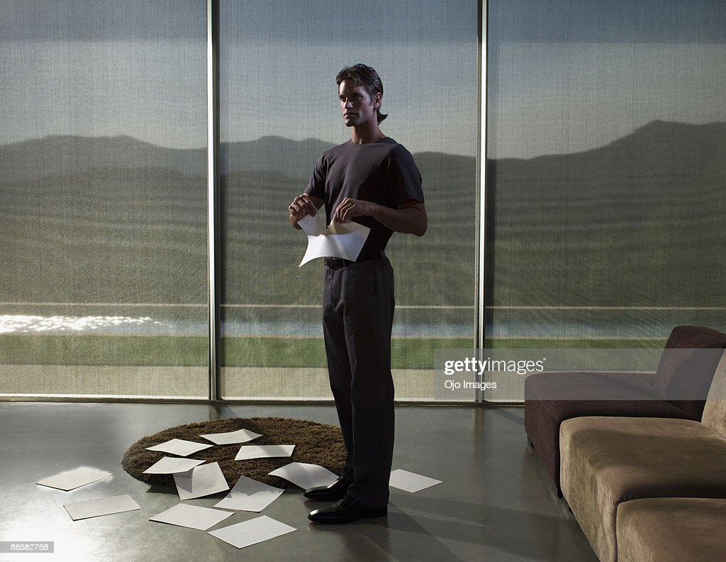 Man tearing piece of paper : Photo