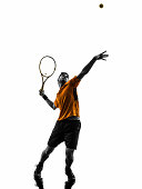 one man tennis player at service serving silhouette in silhouette isolated on white background