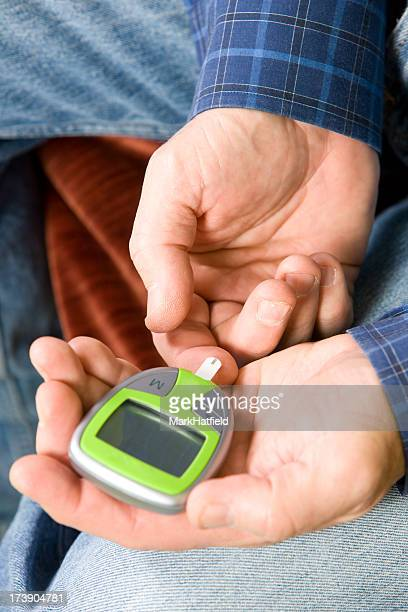 Man Testing His Blood Sugar With Glucometer