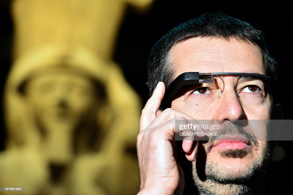 A man tests a pair of Google glasses equiped with LIS (Italian Sign Language - 'Linguaggio Italiano dei Segni') capabilities and created to help deaf people during their visit of the Egyptian Museum in Turin, on November 11, 2013. The Museum of Egyptian Antiquity ('Museo delle Antichite Egizie') in Turin is dedicated solely to Egyptian art and culture, and it is the first museum of its kind to use the interactive glasses to assist deaf people during their visit. An actor using sign language is projected onto the small video screen integrated into the glasses, thereby providing historical information and explanations to deaf visitors throughout the exhibition.