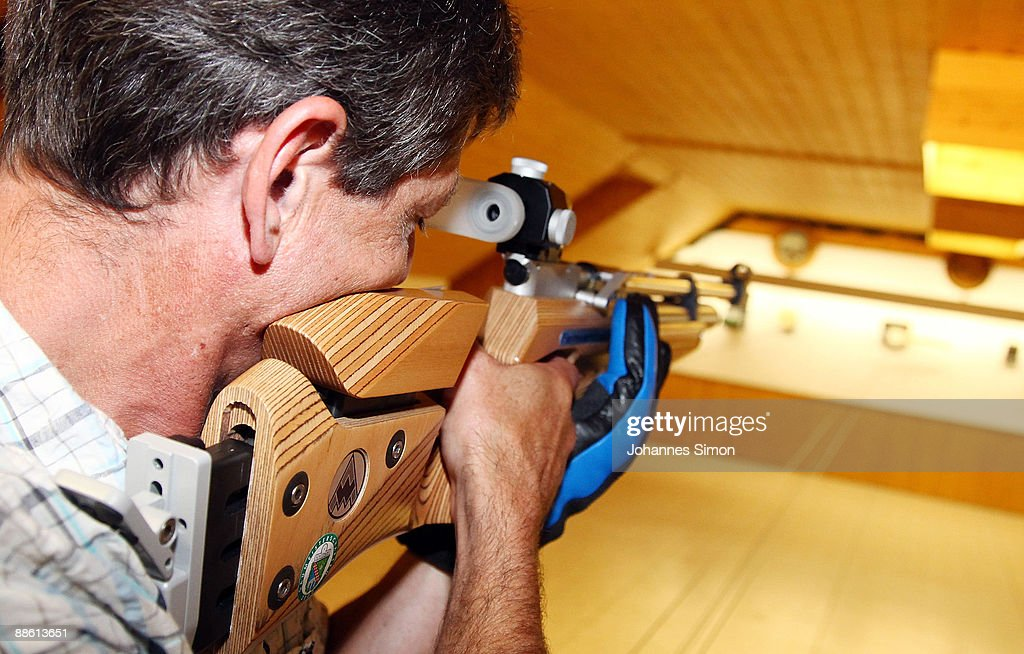 A man tests sporting arms during a familiy open day of shooting club 'Gut Ziel' ('Aim Well') on June 21, 2009 in Olching-Geiselbullach, Germany. After Winnenden school shooting gun control debate is continued in Germany. In Olching parents are astonished about school officials who plan an installation of a shooting stand in the dwelling of recently built school.